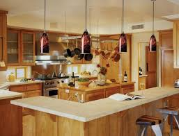 lighting above kitchen island. red oak wood cordovan lasalle door lighting over kitchen island backsplash shaped tile travertine sink faucet above