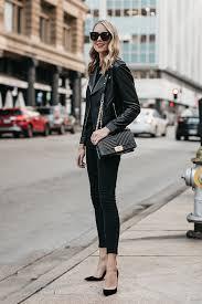 blonde woman wearing club monaco black leather jacket black sweater black skinny jeans black pumps chanel