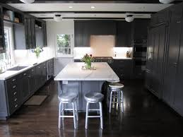 grey kitchen cabinets with dark wood floors