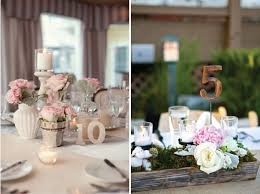 another diy alternative are frames print out the numbers at home and then some frames that match your wedding style modern classic or vintage