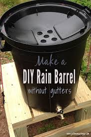 20 gallon trasn can on a wooden stand serving as a gutterless rain barrel system