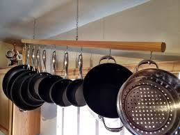pots and pans on wall hang your pots and pans pot pan wall rack beautiful ideas