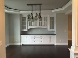 tray ceiling pottery barn paxton cabinets chandelier light sideboards and black hutch cabinet kitchen off white table wood storage wine glass sideboard