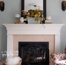 decorations stunning everyday fireplace mantel decor with glass candle holder and black frame wall mirror