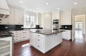 white kitchen cabinets with black countertops. Kitchen With White Cabinets And Black Granite Countertops Wood Flooring