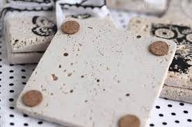 turn tiles into coasters by stamping them with paint