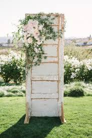 greenery outdoor wedding decoration ideas with old door