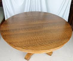 you can sit six comfortable around this table is very sy with the split pedestal base can expand another 52 but we do not have the leaves