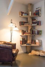 This bookshelf a really cute way to create a mini library, growing from the  floor straight up to the ceiling the log trunk sports a canopy of shelves  that ...