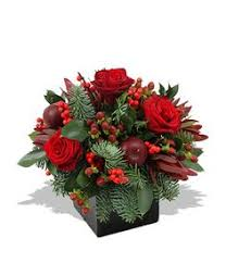 christmas floral arrangements - red roses in a square container