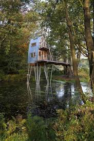 ... wishing to create a dual-purpose extension to their lives and better  take advantage of one section of their forested property, this cabin floats  above a ...