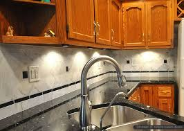 black countertop white marble backsplash tile