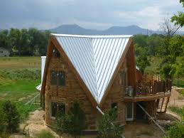 timber frame   fineartinhomebuildingOn this day they were starting to mount all the solar hot water collectors on the Main House