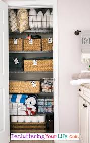 simple diy ideas to declutter and organize your linen closet