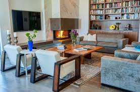 contemporary living room with corner fireplace. Inspiring Interior Designs Focused On Corner Fireplaces : Contemporary Living Room Deiggn With Modern Armchairs And Fireplace B