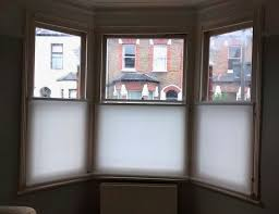 The Most White Venetian Blinds Covering Bay Windows Revealed Roller Blinds Bay Window