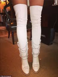 chanel knee high boots. #sexonlegs: the rip singer seemed besotted with her new footwear that covered almost all chanel knee high boots