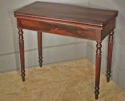 reeded legs on rosewood game table