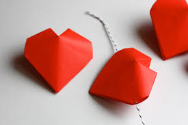 each heart is folded from one square of paper the openings in the sides make it easy to string them into a garland just think by valentine s day you