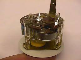 porsche 911 928 944 vdo clock repair 1965 1989 pelican parts the pcb removed you can get access to do the gear repair in my clock i did the gear repair very carefully epoxy and then found