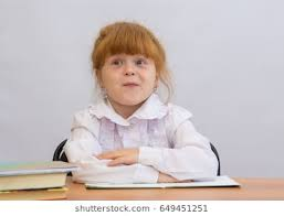 student sitting at desk hands folded. Unique Sitting Little Girl Sitting At The Desk With His Hands Folded In Front Of Him Throughout Student Sitting At Desk Hands Folded R