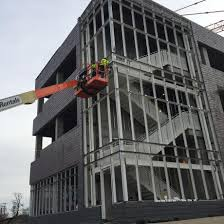 crews prepare the steel structure on the west staircase to support installation of the glass curtainwall