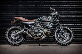 british bike down out cafe racers has showcased their talent with this stunning rendition of a custom ducati scrambler