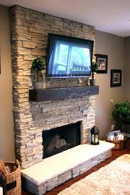 mount tv over fireplace stone loveandforgetme