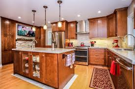 modern country kitchens. Modern Counry Kitchen Design With Cherry Oak Cabinets, Stainless Steel Appliances, And A Light · Country Kitchens