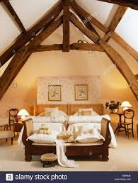 Ceiling Beds High Beamed Apex Ceiling In French Country Bedroom With Sofa At