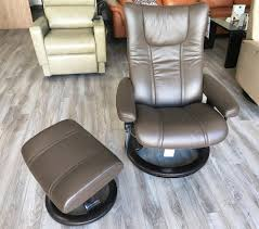 stressless wing recliner chair and ottoman in paloma chestnut leather