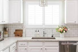 white granite kitchen countertops with white subway tile backsplash
