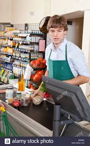 A Cashier Working In A Supermarket Stock Photo 279363758