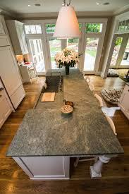 Granite Kitchen Islands With Breakfast Bar Costa Esmeralda Granite Warms Up This Kitchens Island And