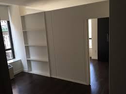 custom room divider with bookcase and single pocket door call us