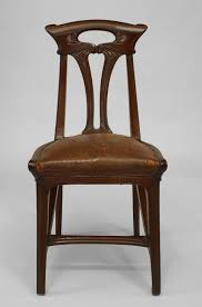 set of four french art nouveau walnut and leather side chairs by