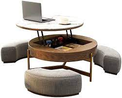A small, circular side table fits underneath a large coffee table, so you can spread them out around the room for a cohesive look, or save space until company comes over. Amazon Com Creative Round Coffee Table And Liftable Desk Tempered Glass Table Top With 3 Combined Stools For Living Room And Office Kitchen Dining
