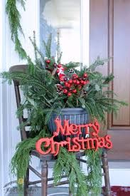 Beautiful Christmas front porch decor inspiration! Love the Christmas porch  pots and natural evergreen rope