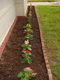 best design flower bed ideas with long shape garden flowers bed and red brick color garden flowers bed borders and green garden grass