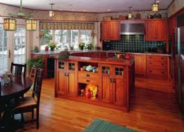 a spectacular revival kitchen by the kennebec company features oak cabinets with craftsman furniture pulls