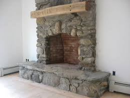 field stone fireplace from vermonthomeandhearth com