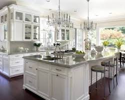 2 chandeliers all white luxury kitchen industrial bar stools gray granite countertop dark wood flooring natural lights stainless steel undermount sink