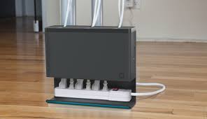 Plug Hub Power Strip Organizer Keeps your Surge Protector and Cords Tidy