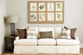 hang a large bulletin board over your sofa and rotate your art in and out