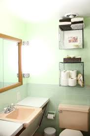 wall towel storage. Hanging Wire Baskets For Vertical Storage Is Such A Cute Way To Organize Your Bathroom! Wall Towel