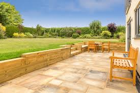 a retaining wall built with wooden sleepers