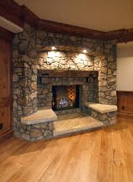 built in seating around fireplace i don t like this stone example but i do like the idea of either seating or built ins around fireplace