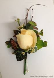 winter woodland wedding theme pin corsage using cream avalanche roses waxflowers copper fircones and twigs wedding flowers liverpool merseyside