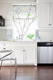 white kitchen with half tiled gray subway tile backsplash