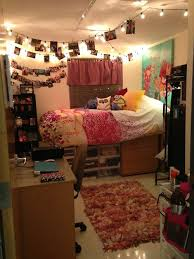 12. Hang your pictures and lights from the ceiling like so. Add curtains, a  colorful rug, and giant posters for a really cool feel. cool dorm rooms
